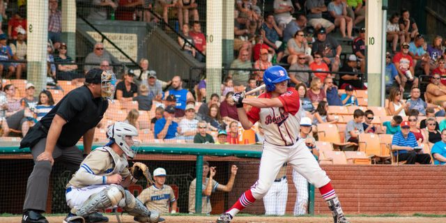 Bombers Open With 11-7 Win